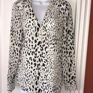 Ivory animal print cuffed zip neck blouse.